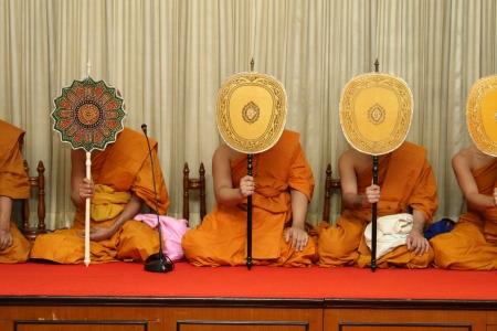 chanting prayer,the monk are praying behind taliput fan Stock Photo