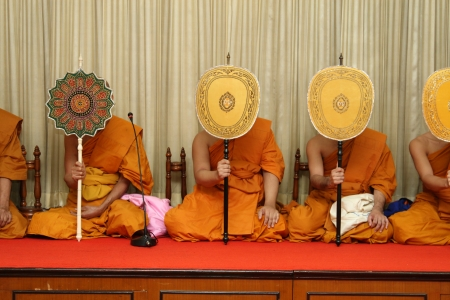 chanting prayer,the monk are praying behind taliput fan Stock Photo