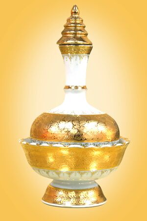 the golden pouring pitcher made from ceramic use in religion ceremonial