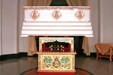 the white thai coffin in front of the crematoria burner