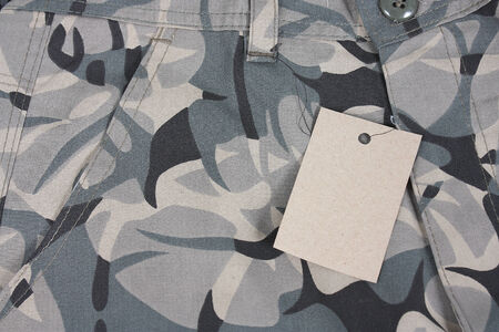 close-up pale green camoflauge pocket pants with tag Stock Photo