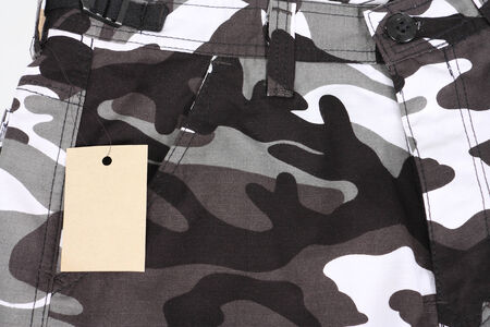 close-up B&W camouflage pocket pants with tag