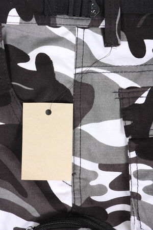 closeup B&W camouflage pocket pants with tag Stock Photo
