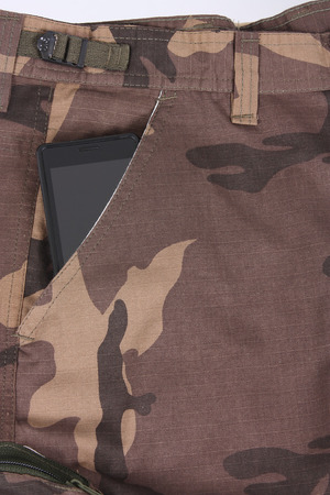 telephone in the pocket of camoflage shorts