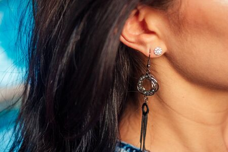ear of a happy woman with a beautiful earring 스톡 콘텐츠