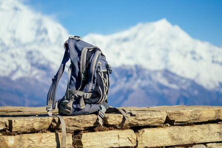 A hiking gray backpack on the background of the mountains in Nepal 写真素材