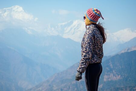 Smiling young beautiful and active woman in trekking in the mountains. the concept of active recreation and tourism in the mountains. trekking in Nepal Himalayas