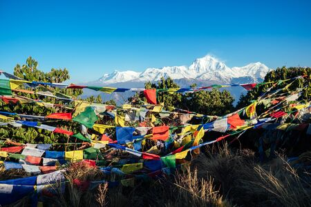 beautiful view of the landscape of the Himalayan mountains. Snow-covered mountain tops and Tibetan multi-colored prayer flags. trekking concept in the mountains