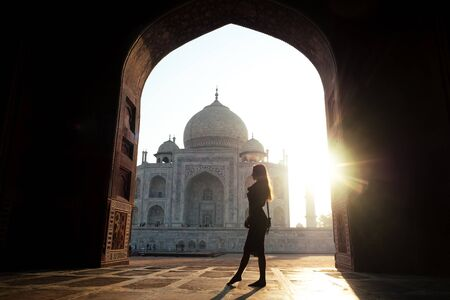 young girl tourist looking to the Taj Mahal in Agra, India . concept of culture, tourism and religion 版權商用圖片