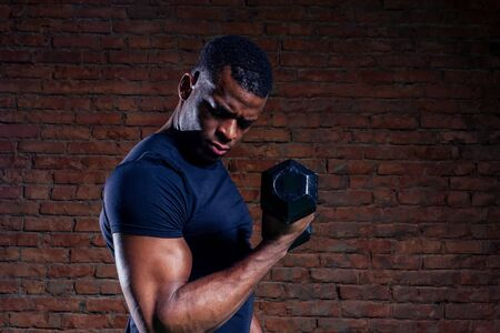 muscular african american man exercising with dumbbell Reklamní fotografie