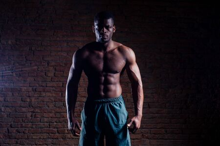 athlete in the gym doing exercises for abdominal abc muscles Reklamní fotografie