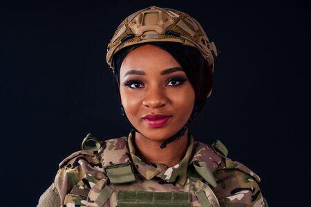 latin female indian soldier studio black background Foto de archivo