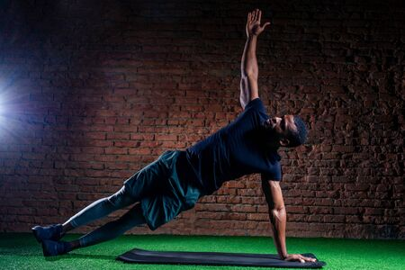 athlete in the gym doing exercises for abdominal abc muscles