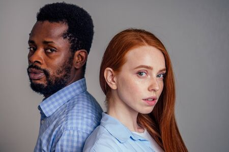 young redhead freckled woman with boyfriend, looking at the camera