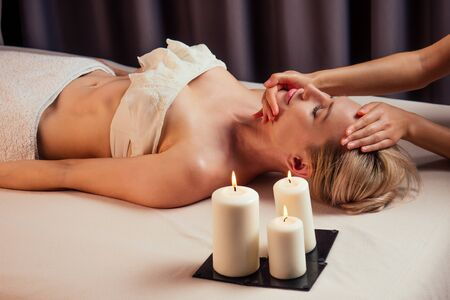 beauty blonde glamour female in spa eyes closed enjoying head massage at spa center professional therapy health stress treatment pampering facial beauty skin:anti acne and anti wrinkles. Stock fotó
