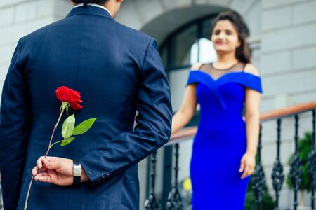 indian woman in long evening blue dress spinding romantic time together with lover handsome boyfriend europe urban downtown city Archivio Fotografico