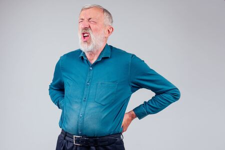 sick senior old man suffering face expression,spine ache pain in studio white background