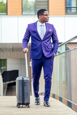 Afro american man well dressed and successful african businessman walking train at railway station bus station. a trip to a business meeting in the capital to business partners