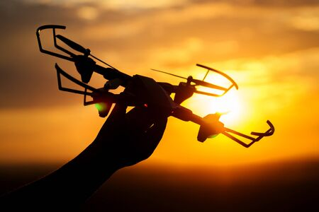 drone in the hand of a man in the sunlight Stok Fotoğraf