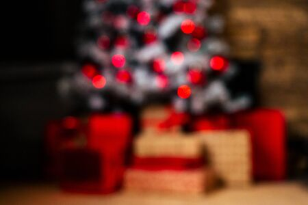 blurred close up copyspace composition of christmas studio room with fireplace and new year tree.Christmas Eve and New Years morning,magic and sorcery copy space