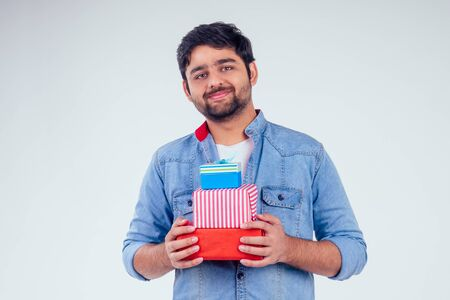 handsome turkey man giving gift boxes in studio white background.New year or Ekadashi concept
