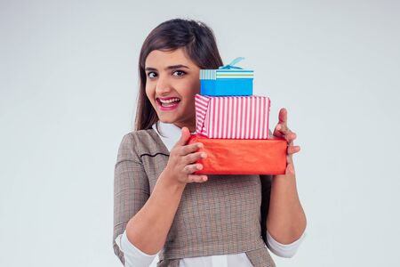 beautiful turkey woman giving gift boxes in studio white background.New year or Ekadashi concept