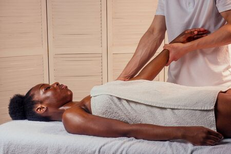 beautiful african american female getting Ayurveda massage