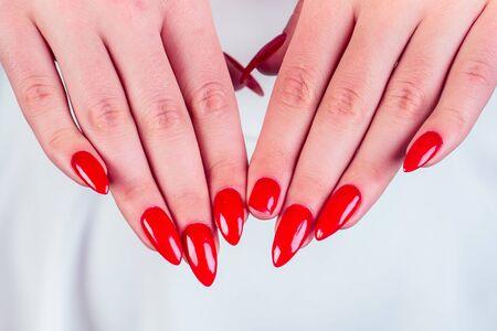 close-up broken fingernail red long nails manicure broken nail in studio salon. Imagens