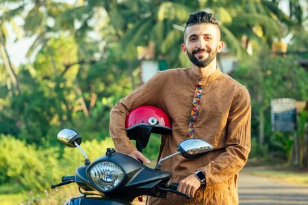 indian man wear helmet and ready to driving explore india attractions of Goa