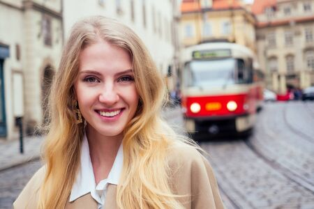 blonde woman stand in bus stop and waiting trolley in Prague sity Chezh Stock Photo