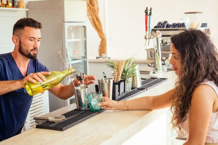 arabic man bartender making fresh coctail for lady