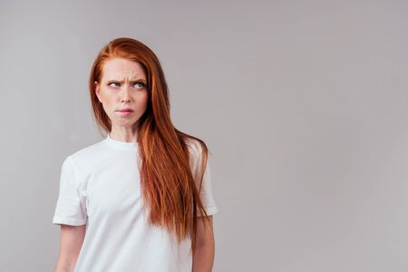 redhair ginger woman feeling angry and irritation studio background Banco de Imagens