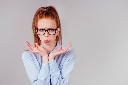 redhair ginger woman disappointed looking studio background Stock Photo