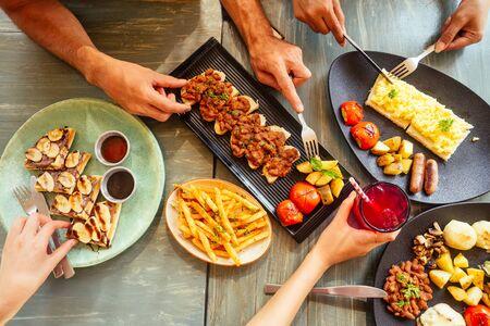 Group of friends having breakfast in the restaurant Reklamní fotografie