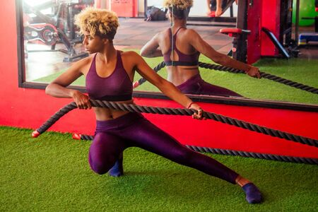 african american woman working out with ropes