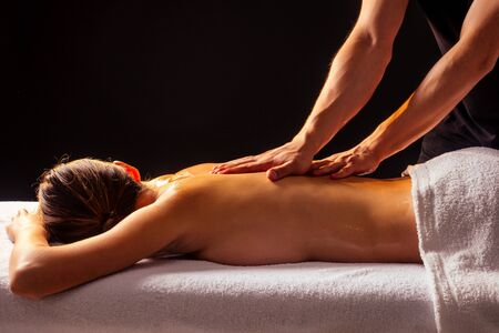 woman having back therapy yoga massaging in gym spa. Stock Photo