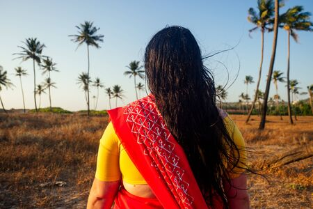 women in saree at tropics back site Stock Photo