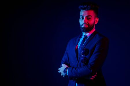 indian young handsome black hair man in stylish business suit in studio isolate white background