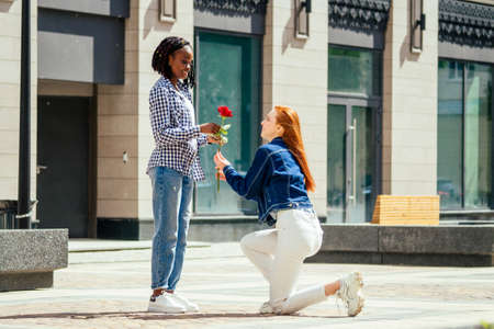 caucasian redhaired ginger woman ask her brazilian girlfriend to be her wife