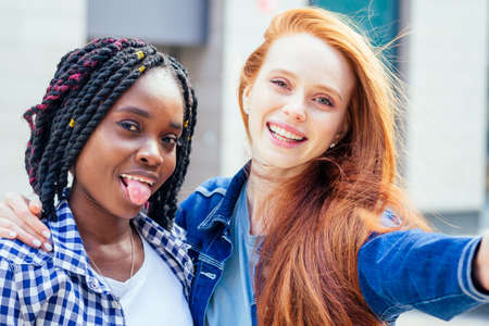 redhaired ginger white woman and her best friens making self photos on camera