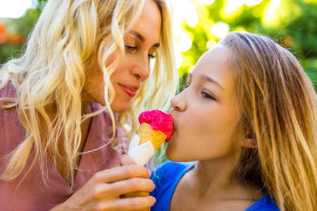 blonde mom and her cute child in summer beach seaside in tropics