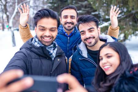 arabic guys having great time on Christmas holidays taking selfie photo on phone