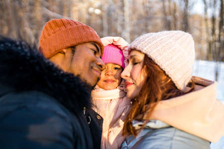 happiness excited people in warm clothing in winter outdoors