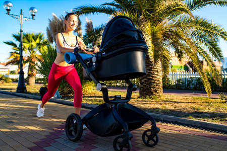 blonde beautiful woman ready to be the best mother and getting in shape after giving birth in tropics background beach