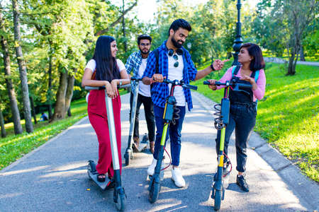 modern indian friends ride on scooter  in park in India 免版税图像