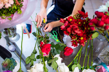 Cropped view of florist making flower bouquet close up