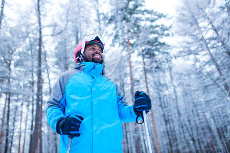 latin american young skier man forest winter day in New Year holidays Christmas