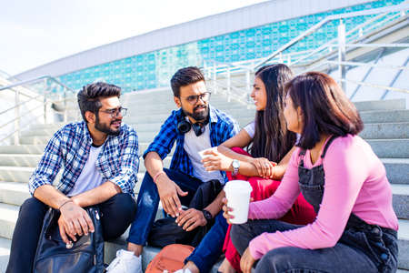indian ethnicity friendship togetherness in park on sunny day Zdjęcie Seryjne