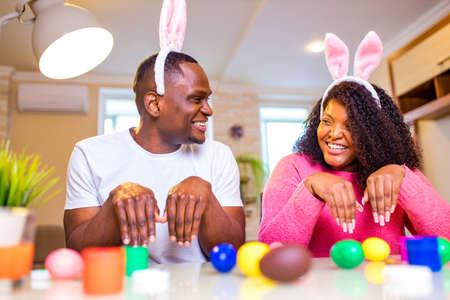 Authentic people african american man preparing for Easter in apartment 版權商用圖片