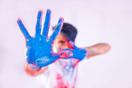 Portrait of happy indian person on holi color on white cotton t-shirt 版權商用圖片